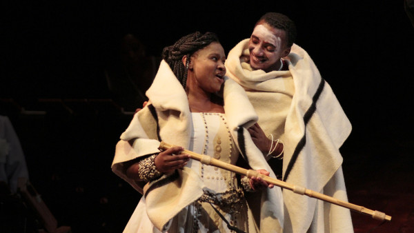 "2.Mhlekazi ""Wha Wha"" Mosiea (right) and Zolina Ngejane in the Isango Ensemble's ""The Magic Flute"" at The Broad Stage in Santa Monica"