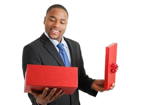 Man-opening-gift-