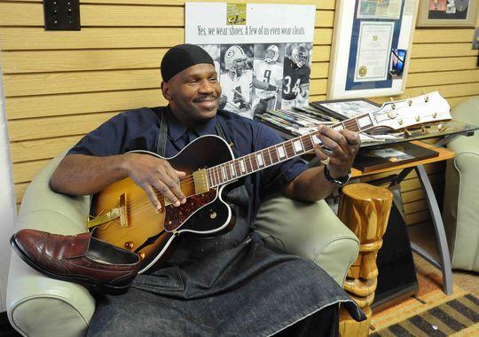 Shoe repairman and musician, James Napier