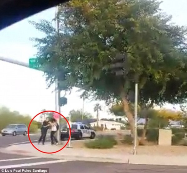 Police officer tussels with teen before throwing her on the ground using a chokehold