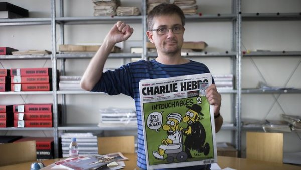 French satirical weekly Charlie Hebdo's publisher, known only as Charb, clenches his fist as he presents to journalists the last issue which features a cartoon of Muhammad. Not sure if he was a victim of the attack.