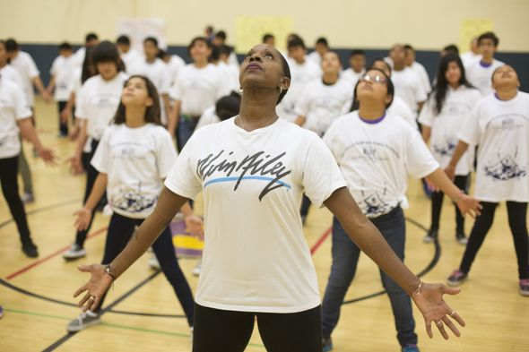 Nasha Thomas-Schmitt leads students in an Ailey Revelations Residency at Washington Carver Middle School, the school Alvin Ailey attended. Photo by Drew A. Kelley
