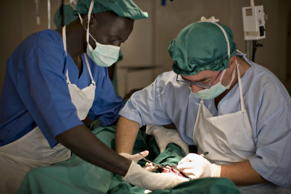Wounded soldier undergoes surgery at a health clinic in south Sudan