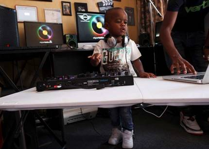 2-year-old Oratilwe Hlongwane, also known as DJ AJ to his fans, plays with a music system at his home in Alexandra, Johannesburg.