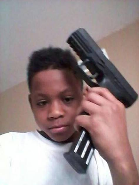Boy posing with gun to head1