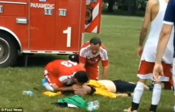 Paramedics try to resuscitate John Bieniewicz, 44, who was punched in the head by a player as he refereed an adult-league soccer match in a Detroit park