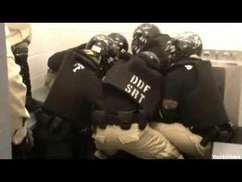 Officers in riot gear tackle the veteran, but no one knows why they are even there.