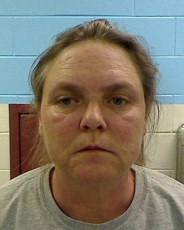 Joyce Hardin Garrad is seen in a booking photo released by the Etowah County Sheriff's Office