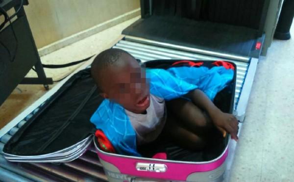 Smuggled boy, suitcase open