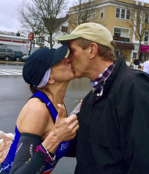 Barbara Tatge (L) and her handsome stranger lock lips at the Boston Marathon