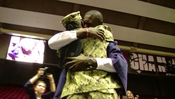 Steven Turner, Jr. and mother, Naval Officer Vera Taylor, embraced when she surprised him by making his H.S. graduation.