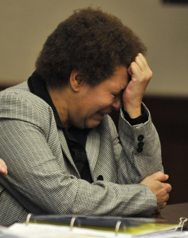 In a Feb. 5, 2015 photo, defendant Tewana Sullivan sobs towards the end of her preliminary examination at 16th District Court in Livonia, Mich. Sullivan, who authorities say killed a friend with a slow cooker during a political dispute in suburban Detroit while very drunk, faces sentencing Monday, June 15, 2015, in Detroit. (Robin Buckson/The Detroit News via AP)