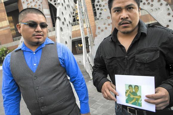 Eutiquio Acevedo Mendez, left, who was wounded in the Gardena police shooting that left Ricardo Diaz Zeferino dead, with Diaz Zeferino's brother