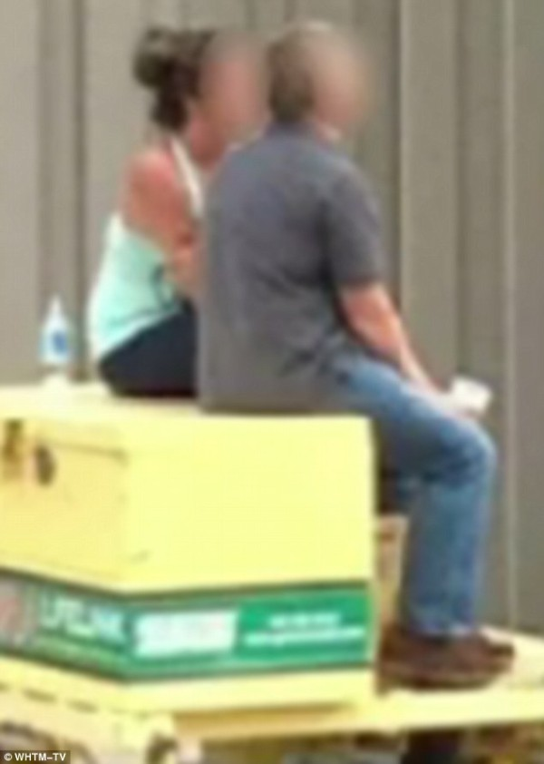 U S Marshal and woman sitting