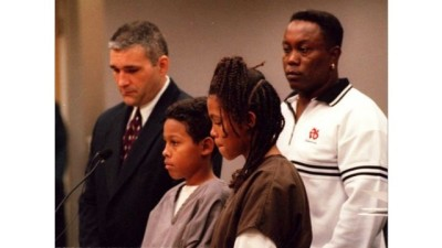 Curtis Jones (Center) and Catherine Jones (Right) appear in court for the first time in 1999 with their attorney and father, Curtis Jones Sr. (Rear)