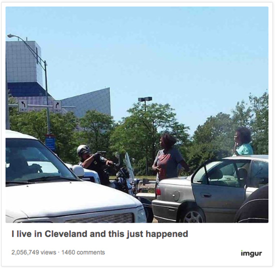Cleveland cop points gun at unarmed woman
