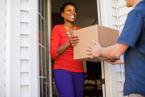 African-American woman receiving a package