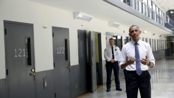 President Obama shares with reporters during visit at El Reno Prison