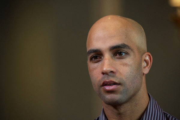 Former tennis star James Blake discusses his mistaken arrest by the New York City Police Department during an interview, Saturday, Sept. 12, 2015, in New York. Video surveillance released Friday of the mistaken arrest shows a plainclothes police officer who has a history of excessive-force complaints grabbing Blake by the arm and tackling him to the ground. (AP Photo/Bryan R. Smith)