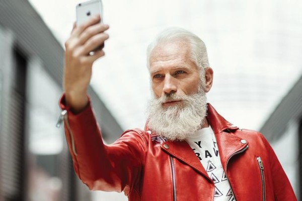 Model Paul Mason is lighting up the Internet with his Santa-esque good looks.