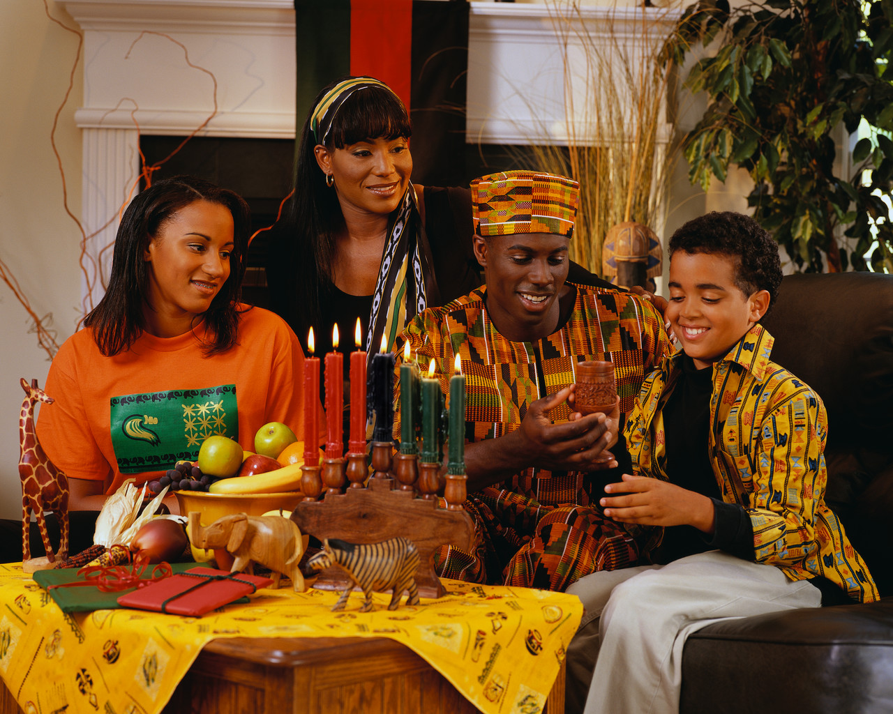 ca. 2001 --- Family Celebrating Kwanzaa --- Image by © Royalty-Free/Corbis