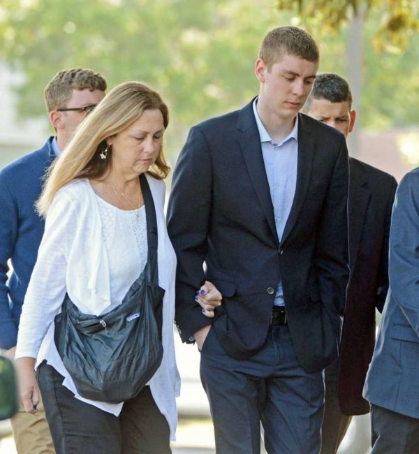 This June 2, 2016 photo shows Brock Turner and his mother, Carleen Turner, headed to the courthouse in northern California's Palo Alto area.