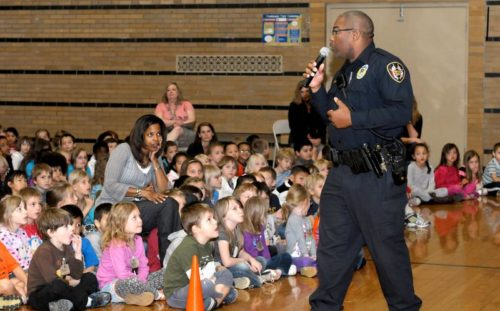 Vanda Bidwell/ The News Gazette with Thilmony story-Urbana Police Officer Preston James speaks.to the K-2nd grades.representatives from Urbana Police,Urbana Fire and the Red Cross at Leal School in Urbana.Urbana Ð To continue to deliver important safety messages to our students and families, the Urbana schoolÕs asked speakers from several organizations to present the topic of ÒStranger Danger,Ó to the districtÕs elementary students. The speakers include a panel of individuals from the Urbana Police Department, the Urbana Fire Department, and the American Red Cross. During the Stranger Danger assembly, each speaker provides the students with different safety information. The presenters discuss where the children could encounter strangers. Who are the safe adults in their lives. Tricks a bad stranger may use to gain the studentsÕ trust and how to respond when approached by strangers. The group also encourages students to know their address, phone number and parentsÕ names. The presenters tell the students to be aware of their surroundings and to try to follow the same way to and from school every day. The panel also talks to students about Òpass codesÓ and encourages them to talk to their families about setting a pass codephoto taken tuesday sept 25,2012