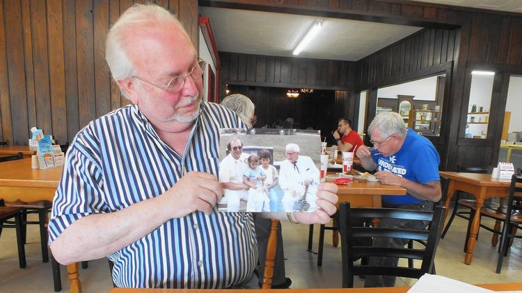 Joe Ledington shows family photos and that man sure does look like the real colonel Sanders.