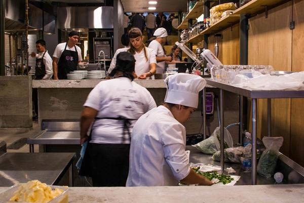 Cooks prepare a dinner for gourmet soup kitchen, Refettorio Gastromotiva in Rio de Janeiro