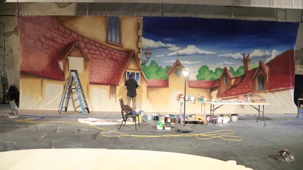 Scenic designer Ian Wilson paints the set of A CINDERELLA CHRISTMAS
