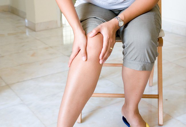 bigstock-Woman-suffering-from-pain-in-k-18061778