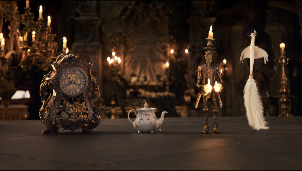 The mantel clock Cogsworth, the teapot Mrs. Potts, Lumiere the candelabra and the feather duster Plumette live in an enchanted castle in Disney's BEAUTY AND THE BEAST the live-action adaptation of the studio's animated classic directed by Bill Condon. ? Disney