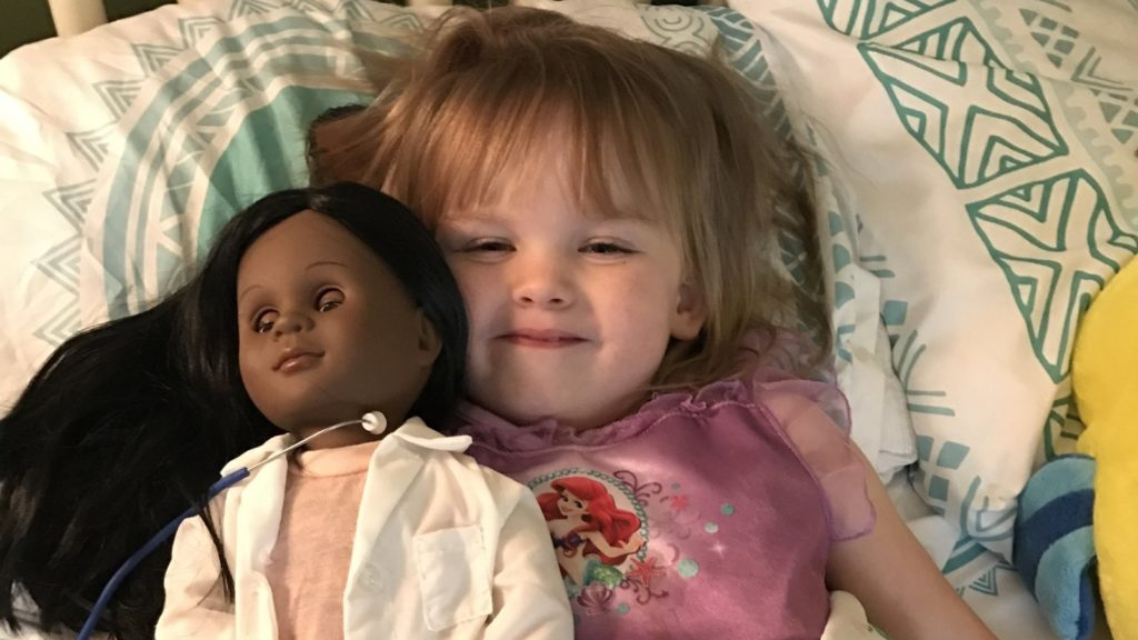 Black doll, white child