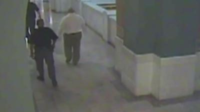 Semen walks to the courtroom with officers. But why are they allowing HIM to lead?