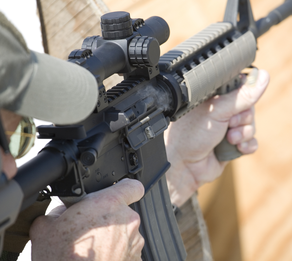 Man-using-AR-15-rifle-Depositphotos
